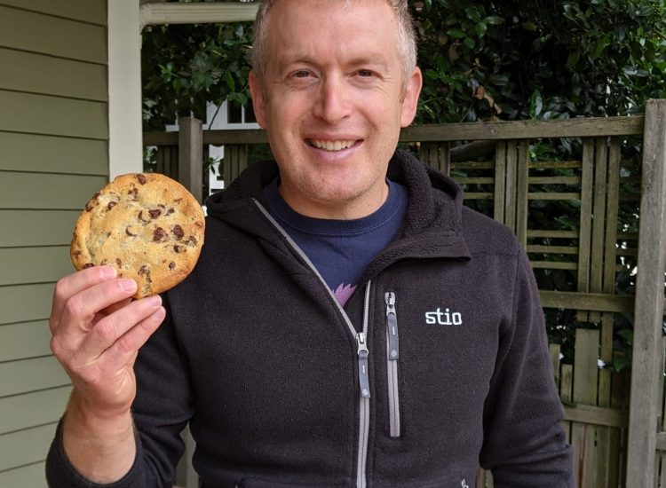 Man holding cookie